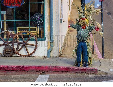 Halloween Scarecrow Display On Street Corner Of Small Town