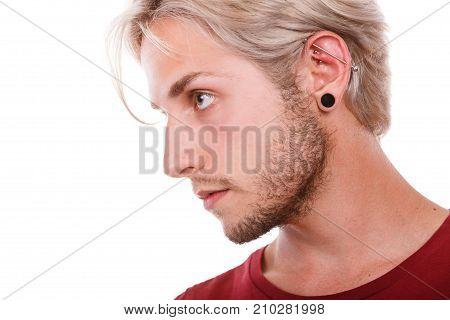 Teen Boy With Piercing And Fashionable Hairstyle
