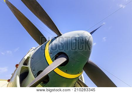 Old military aircraft propeller closeup on sky background