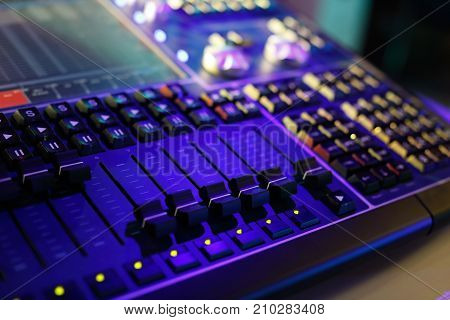 Compact lighting control console for music shows and concerts. Selective focus.