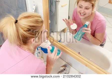 Woman Applying Tonic On Cotton Pad