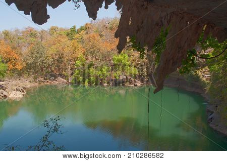 Beautiful Pandav falls lake at Panna National Park Madhya Pradesh India. It is located in Panna and Chhatarpur districts of Madhya Pradesh in India. It has an area of 542.67 km2 a tiger reserve.