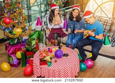 Group Of Friends Enjoying Christmas Party at home.