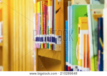 Books on book shelf in library room abstract blur de focused background