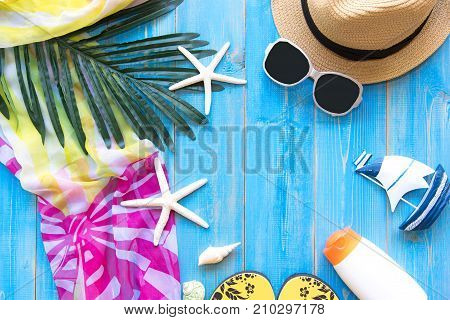 Summer Fashion woman big hat and accessories vintage camera and sunglasses go to travel in the beach. Tropical sea.Unusual top view background. Summer Concept.