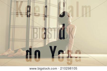 A young woman performing yoga-asanas in the hall. Ardha matsyendrasana