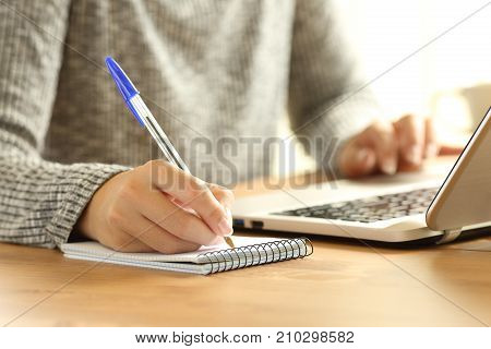 Woman Hands Taking Notes In A Notebook