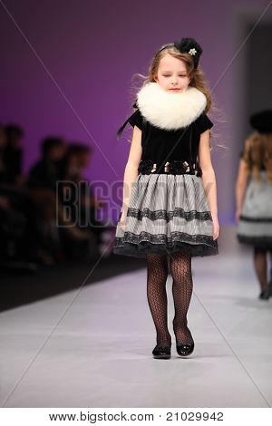 MOSCOW - FEBRUARY 22: An unidentified child model wears a dress from Snowimage and walks the catwalk in Collection Premiere Moscow, main platform of fashion industry in Eastern Europe, on February 22, 2011 in Moscow, Russia.