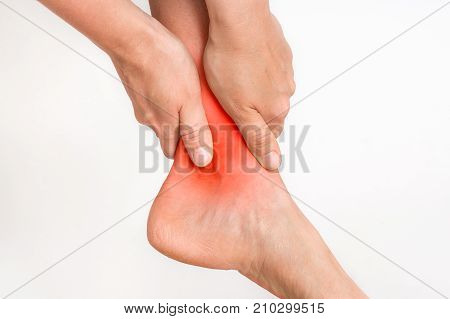 Woman With Ankle Pain Holding Her Aching Leg
