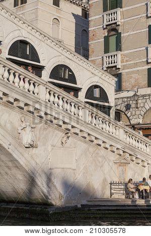 VENICE ITALY SEPTEMBER 20 2017: Rialto Bridge (Ponte de Rialto) over Grand Canal. It is the oldest bridge across the canal