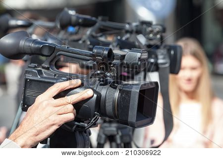 Filming an event with a video camera. Camera operator at work.