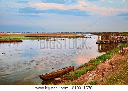 Chioggia, Venice, Veneto, Italy: picturesque landscape at sunset of the lagoon in front of the town