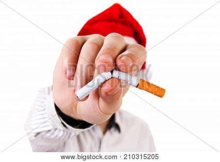 Person in Santa Hat with broken Cigarette in a Hand on the White Background