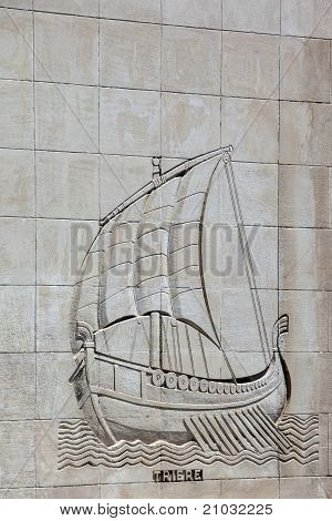 Galley Carved On A Stone Wall