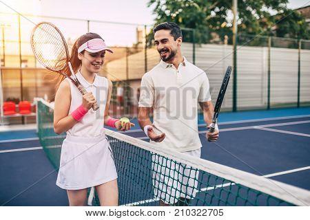 Couple On Tennis Court
