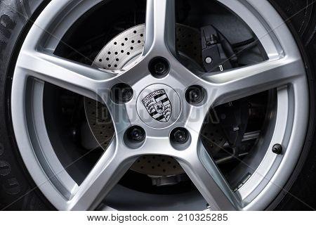 BANGKOK, THAILAND - NOVEMBER 9, 2013: Closeup of Porsche logo on Porsche Cayman 2012 model wheel
