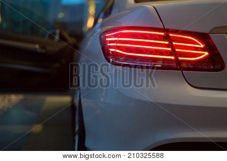 Car detailing series: White car taillight at night