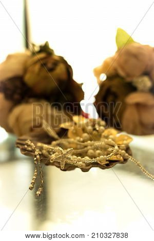 Wedding bouquets behind clam shell full of jewelry