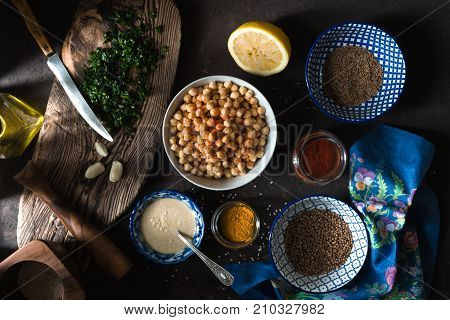 Ingredients for cooking falafel, chickpeas, tahini and spices horizontal