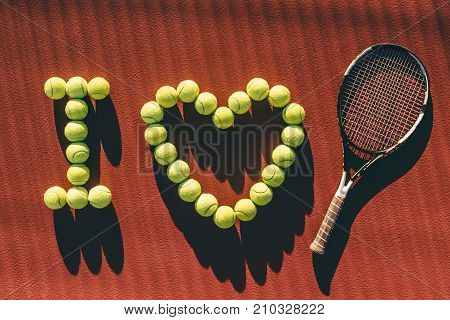 Balls And Racket On Tennis Court