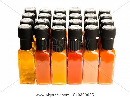 Set Of Hot Chili Sauce Glass Bottles On White Background.