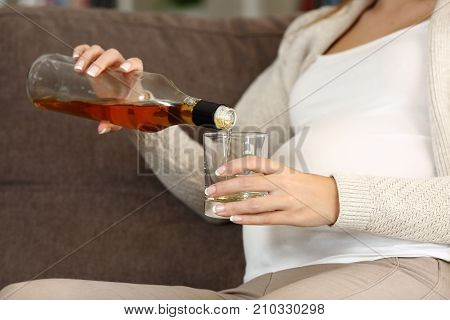 Irresponsible Pregnant Woman Drinking Alcohol