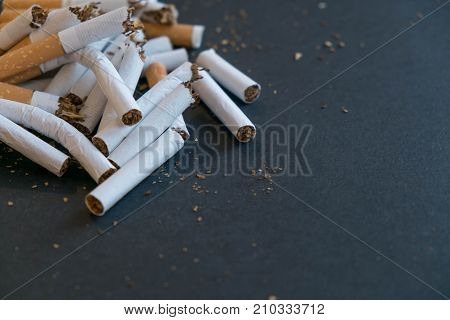 Broken Scattered Cigarettes, Tobacco, Close-up On A Black Background. Top View With Copy Space, Flat