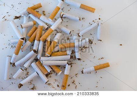 Broken Scattered Cigarettes, Tobacco, Close-up. Top View With Copy Space, Flat Lay. Stop Smoking. Wo