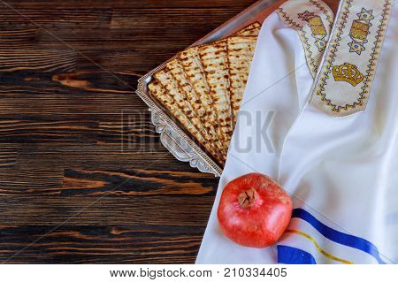 White Plate With Matzah Or Matza And Passover Haggadah On A Vintage Wood