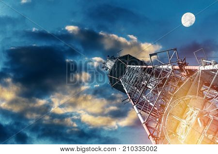 TV tower and plane Telecommunications tower against blue sky in red and white