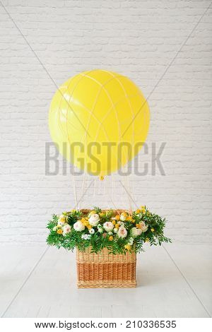 decor for the holiday birthday. balloon with a basket decorated with fresh flowers