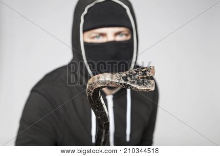 Thief With A Crowbar In His Hand