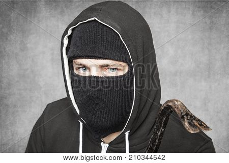 Thief With A Crowbar In His Hand, Close Up