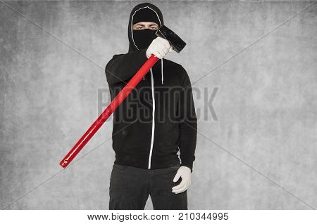 A Masked Stranger Shows An Action Tool