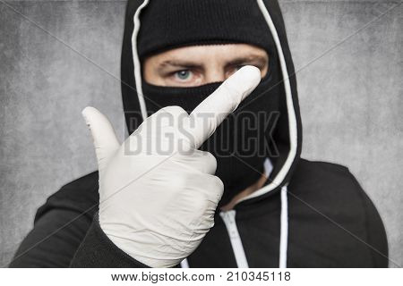 Masked Man Shows Middle Finger