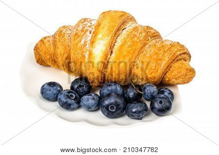 Cappuccino, blueberry and fresh croissant for breakfast. Studio Photo