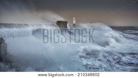 Hurricane Brian The forces of nature engulf the pier and lighthouse as Storm Brian lands on the Porthcawl coast of South Wales, UK.