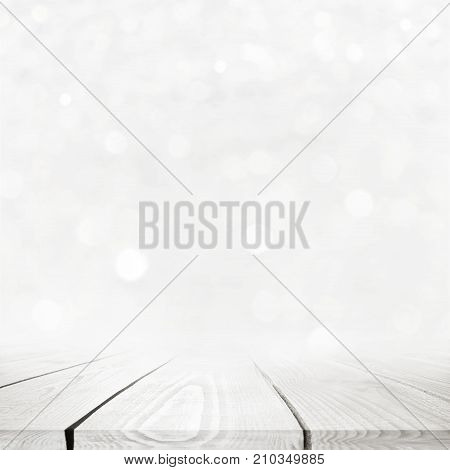 Close up white wood table over beautiful bokeh background. Christmas theme