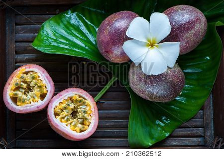 Passion fruit whole and slise on a natural background. Tropical fruits. The Fruit of Passion. Maracuya