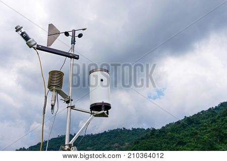 Meteorological Weather Station Antenna With Meteorology Sensors, Pale Overcast Cloudy Sky And Forest