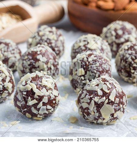 Healthy homemade paleo chocolate energy balls on parchment square format