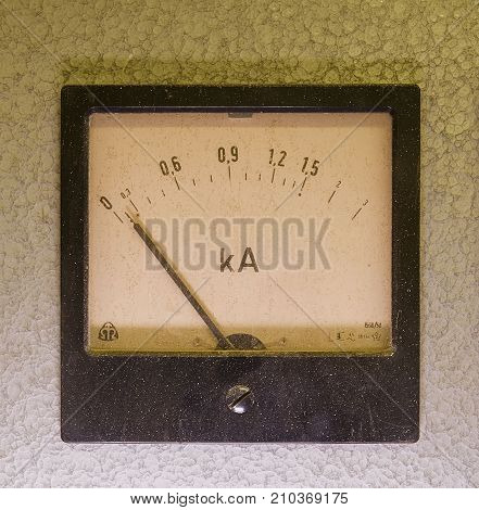 Old analog instrument - Ampere meter isolated on grey background.