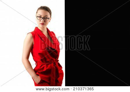 elegant fashionable business woman in red suit on black and white background