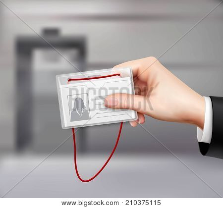 Business id card with red cord displayed in businessman hand closeup realistic image blurred background vector illustration