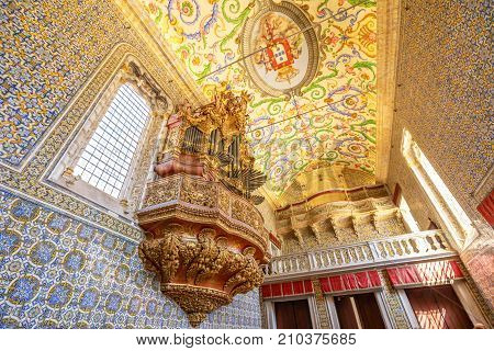 Coimbra, Portugal - August 14, 2017: bottom view of Pipe organ of Capela de Sao Miguel, the Chapel of University of Coimbra, a tourist attraction of university in upper Coimbra, Central Portugal.