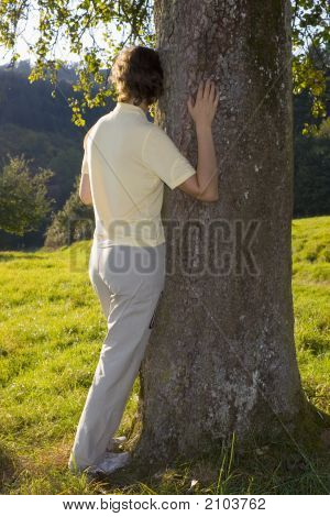 Woman Holding A Tree