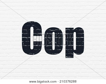 Law concept: Painted black text Cop on White Brick wall background