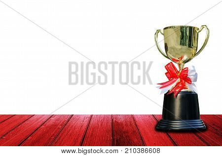 award trophy with ribbon bow on wooden table isolated on white background winner success and congratulation concept