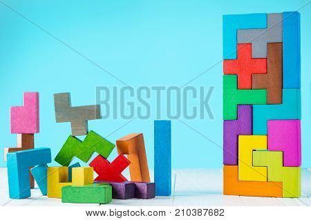 Logical tasks composed of colorful wooden shapes. Visual conundrum. Concept of creative logical thinking or problem solving. Business concept rational solution. poster
