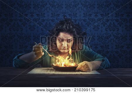 Young woman eating spicy food. Image of concept